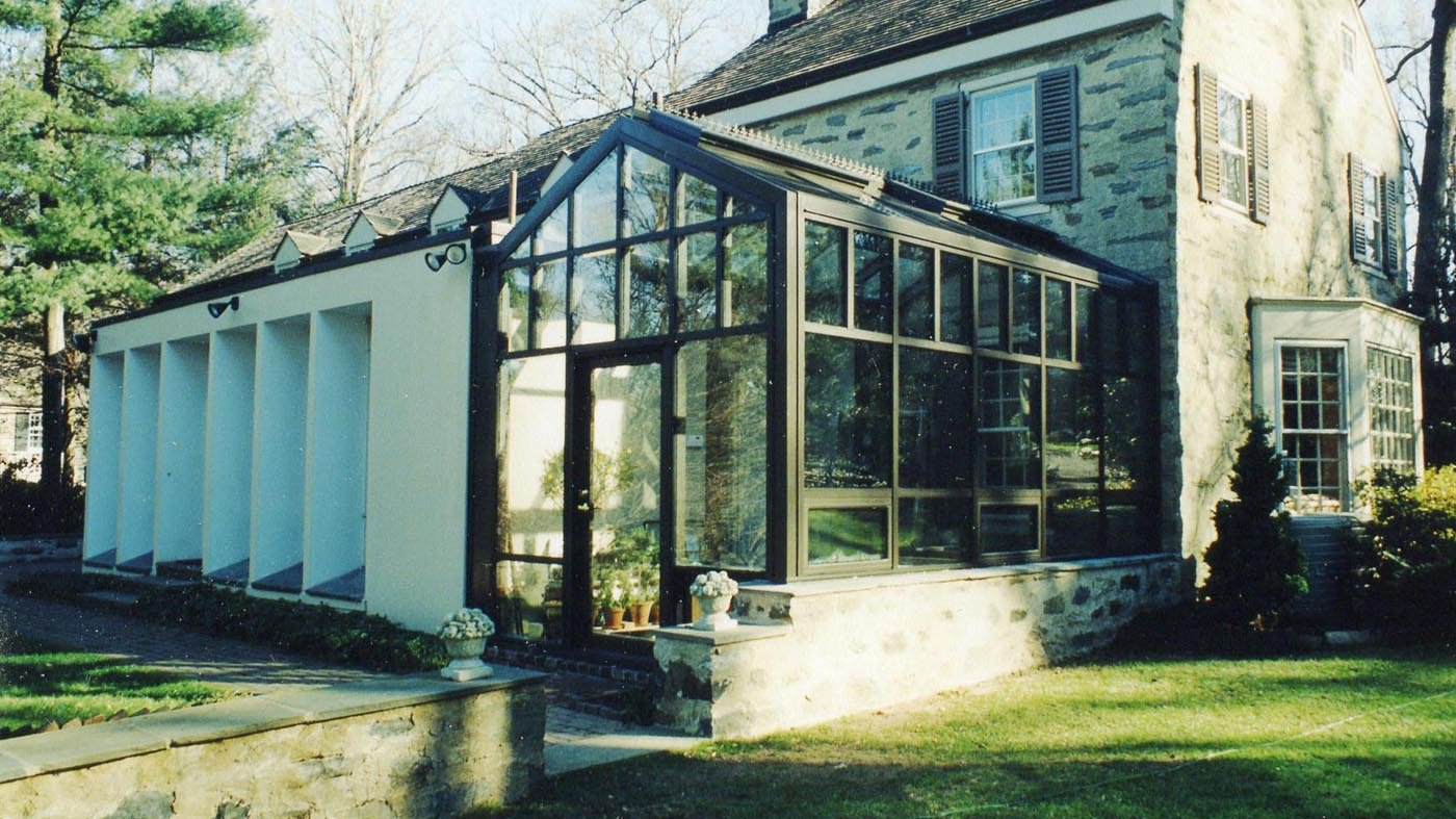 Straight eave, double pitch greenhouse with operable ridge vents, awning windows, ridge cresting, and finial.