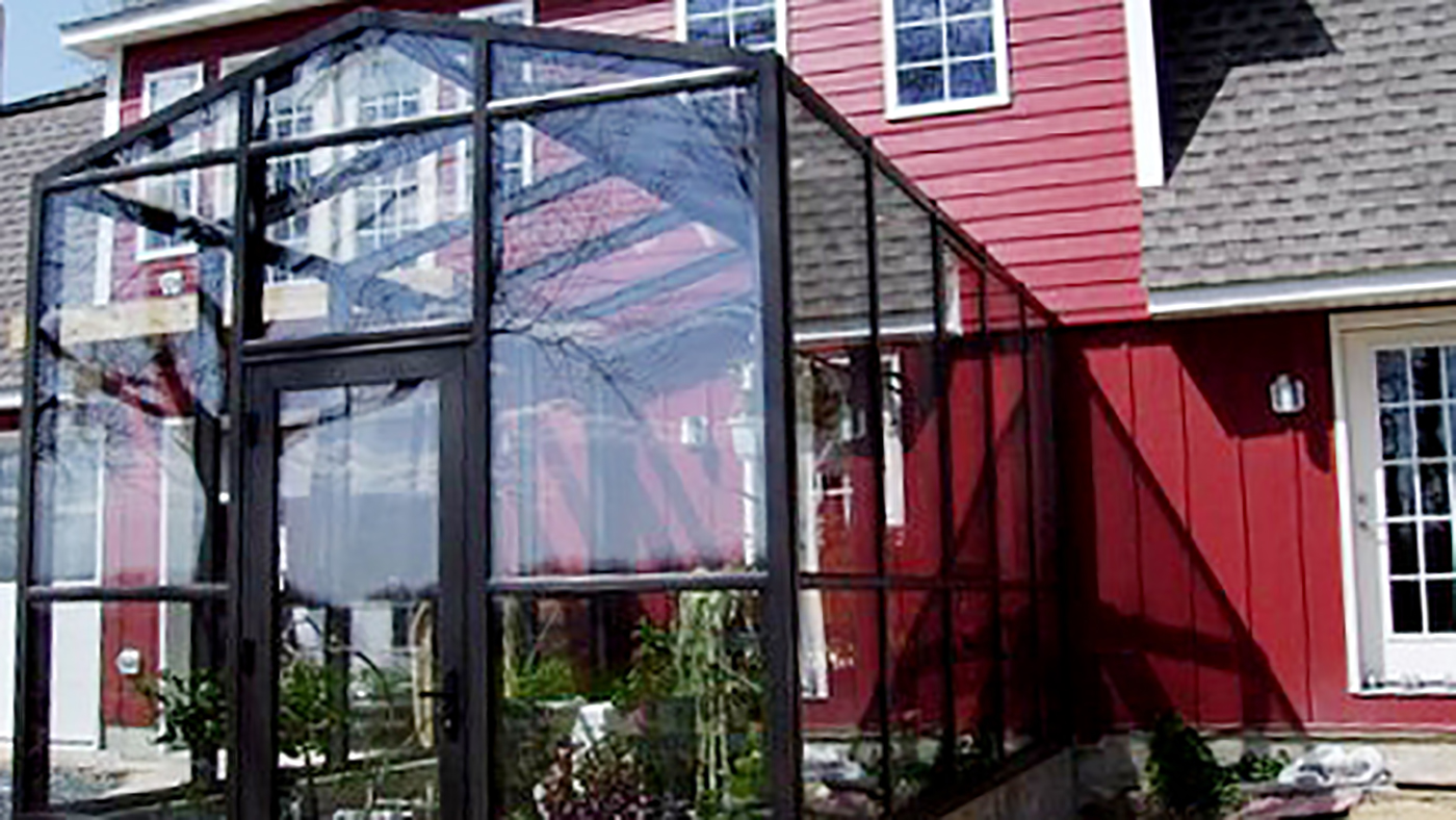 Insulated Straight Eave Double Pitch Greenhouse with one Gable end and terrace door.
