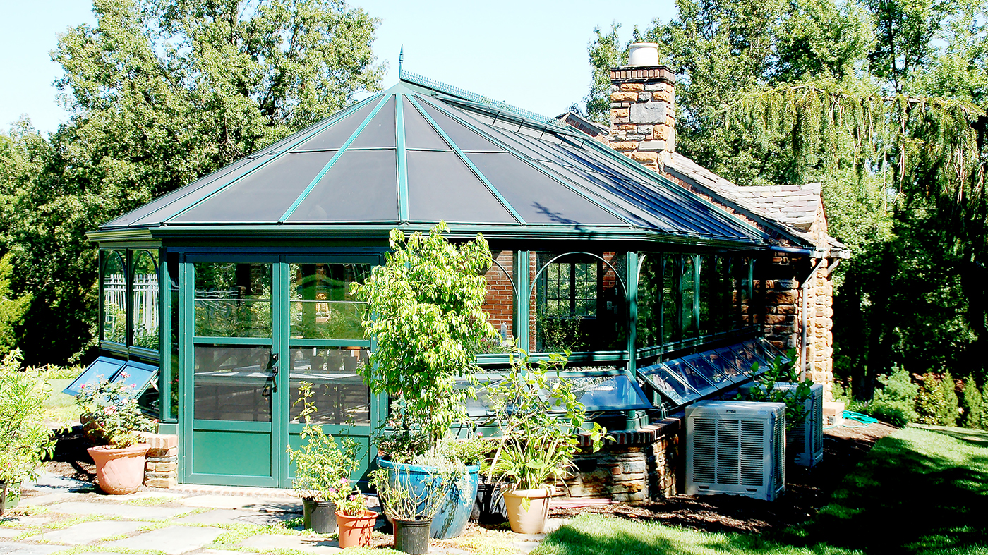 Straight eave, double pitch with conservatory nose, decorative appliques, arched grids and ring and collar ties.
