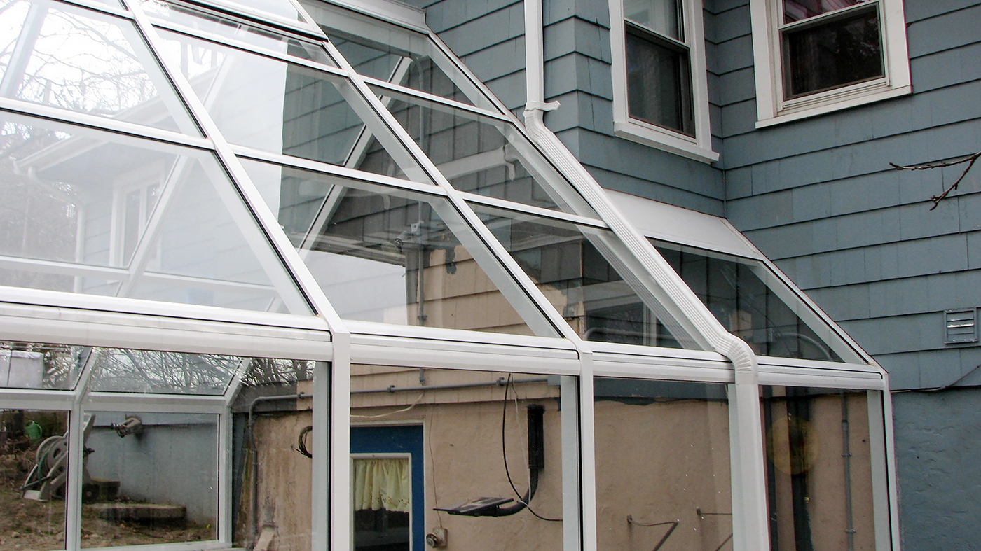 Straight eave double pitch greenhouse with one gable end.