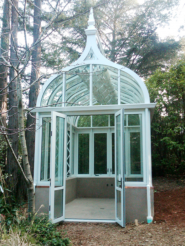 Ogee double pitch conservatory with two gable ends including decorative cresting, finials, gutters, interior truss and roof mounted operable shades.