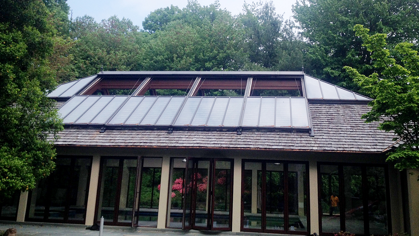 Operable/Retractable double pitch skylight with 2 hip ends. This skylight is perfect to bring the outdoor weather and sunlight indoors but still protect you from the rain if needed.