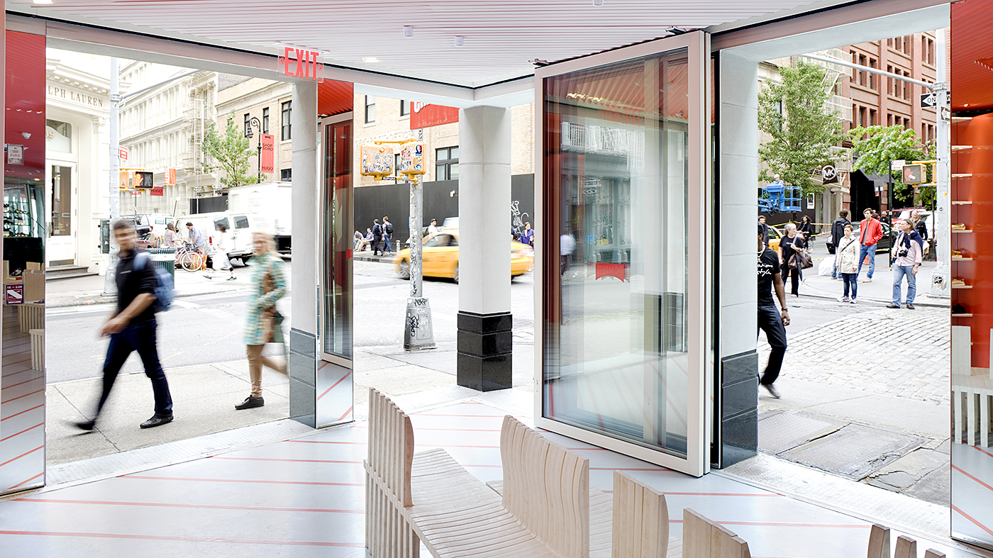 A slide and stack glass wall system with 10 individual panels, one of which is an operable door using an overhead closer, thumb turn and keyed locks, and the entire unit has a recessed tank sill.