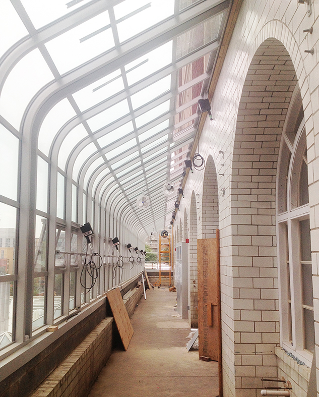 Curved-eave lean to conservatory.