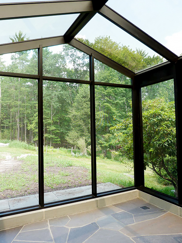Irregular straight eave double pitch screened-in sunroom with a straight leave lean-to section, glass roof, specialty pet screen walls and sliding doors