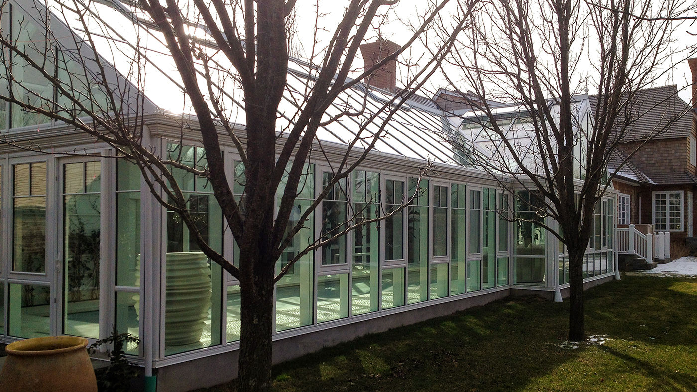Straight eave double pitch pool enclosure with one gable end and two dormers. Unit includes ridge vents, awning windows, terrace doors, gutter and downspout, rake molding, ring and collar along with an exterior finial.