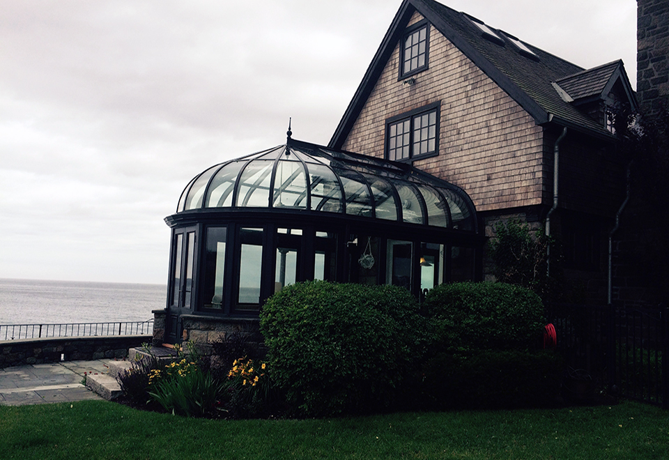 Curved eave conservatory skylight with irregular conservatory nose.