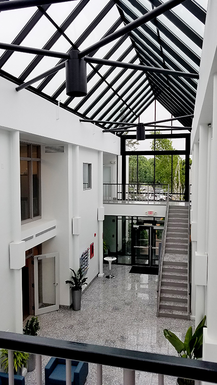 Straight Eave Double-Pitch Skylight with 2 Gable Ends. Vertical Wall Systems and Out-Swing French Terrace Door