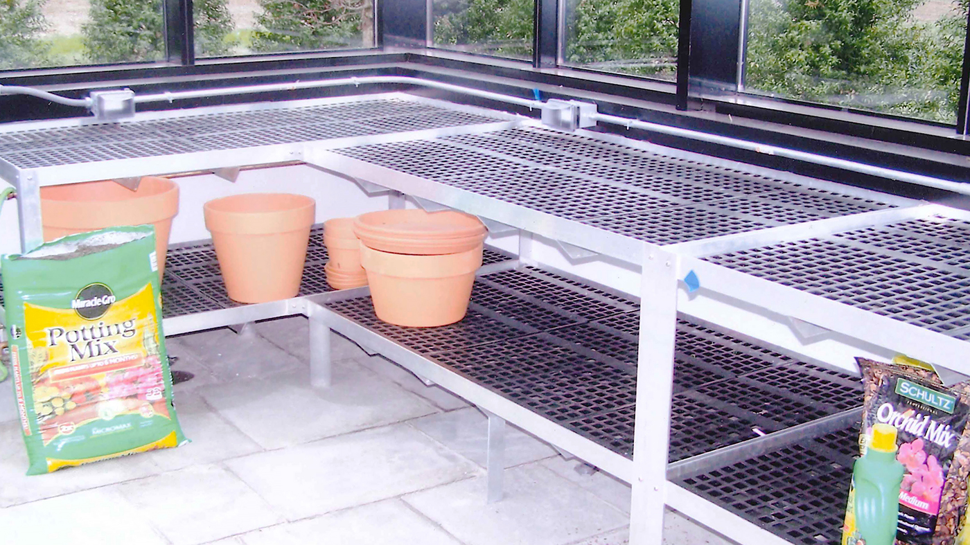 Straight eave double pitch greenhouse with two gable ends, interior partition wall, double pitch entryway, ridge vents, eave vents, French doors and two cold frames.