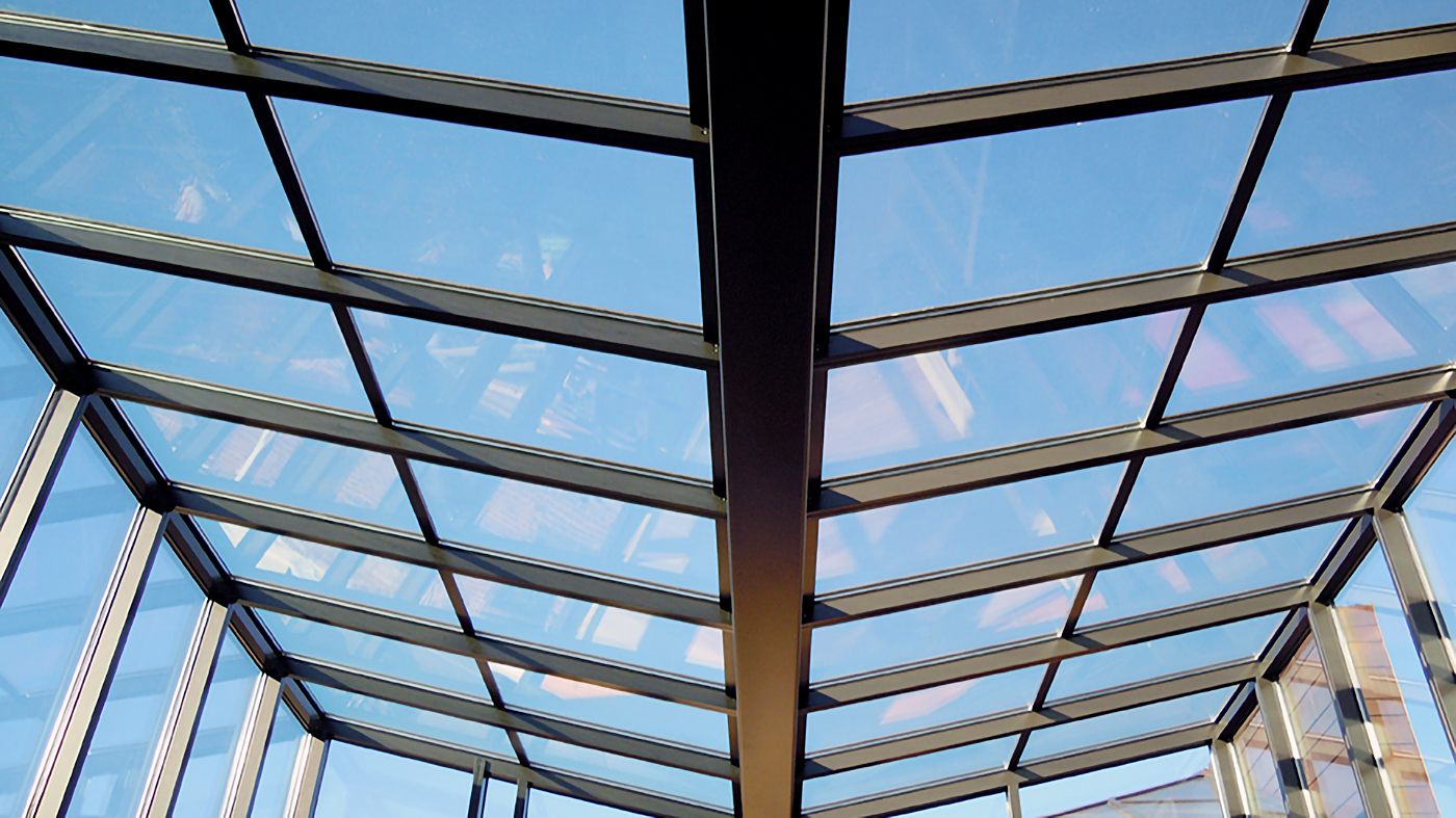 Inverted double pitch sunroom with structural steel gutter
