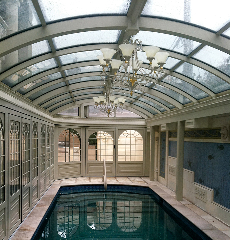 Pool enclosure with slide and stack wall system