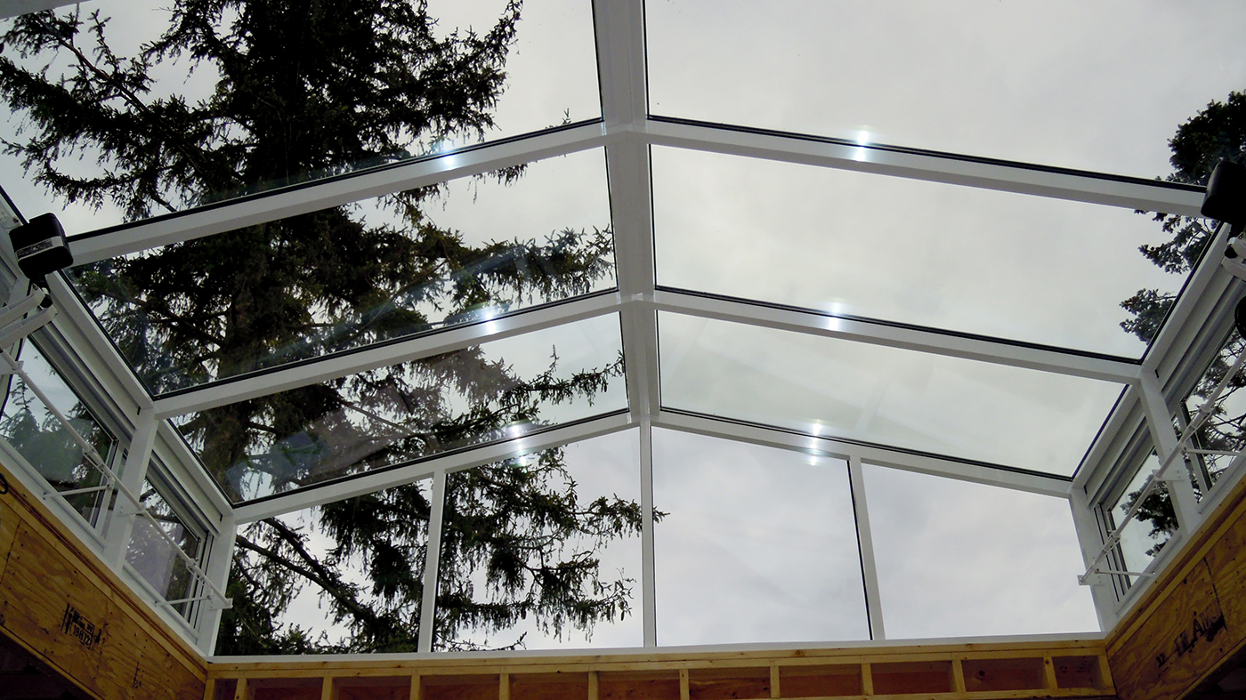 Straight eave double pitch skylight with two gable ends, eave sashes, and decorative elements including finial and ridge cresting