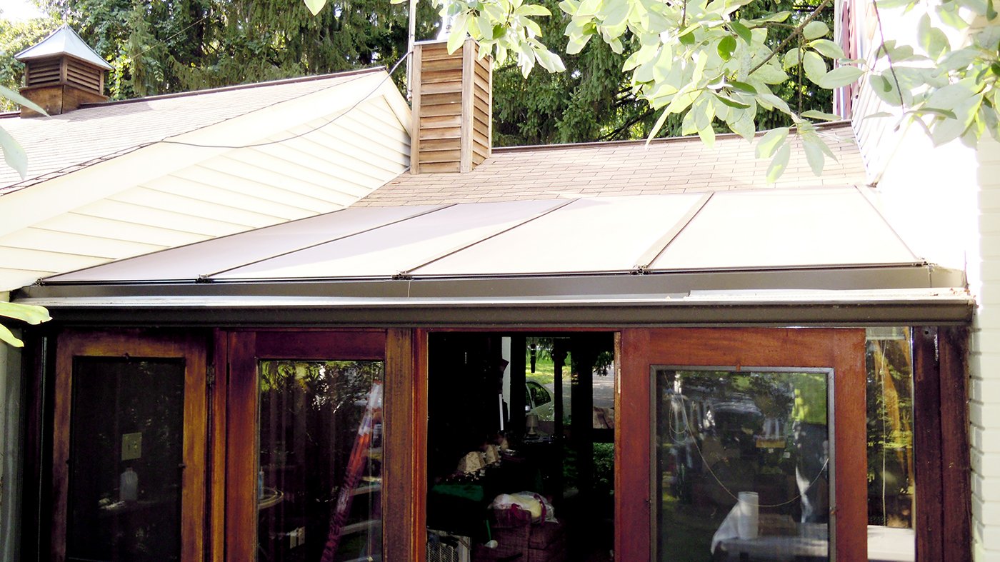 Single slope skylight with exterior roof mounted shades