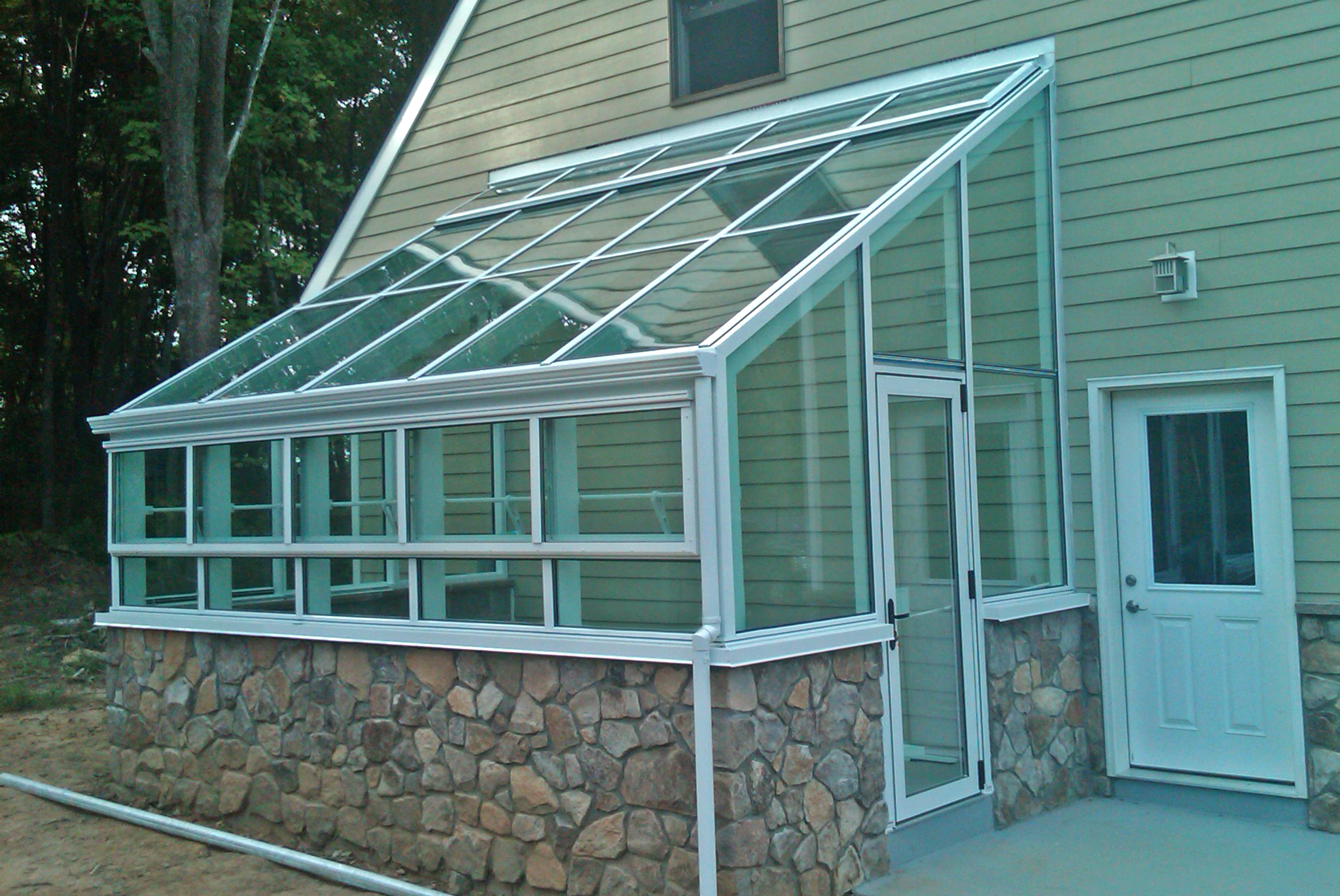 Straight eave lean-to greenhouse.