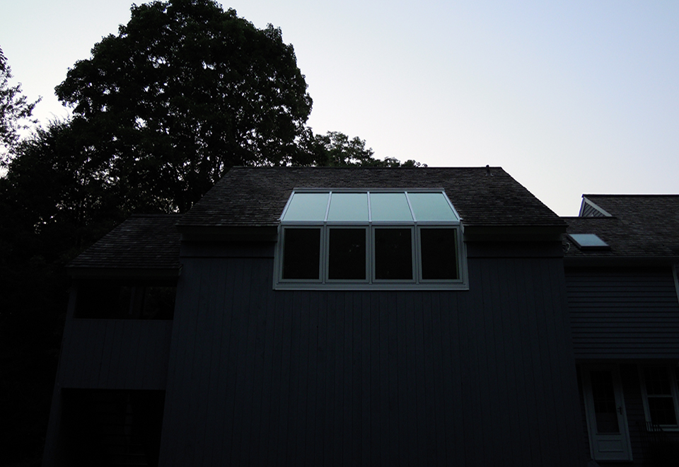 Straight eave lean to skylight with no gable ends, four casement windows and interior Douglas fir veneer.