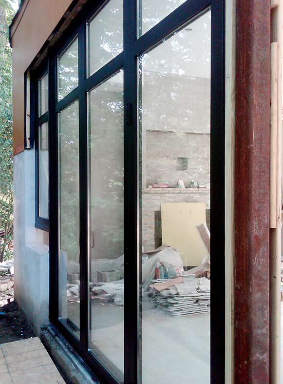 Three sets of bifold doors and two aluminum curtain walls
