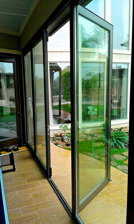 Four sets of folding glass walls with varying configurations, all using recessed sills.
