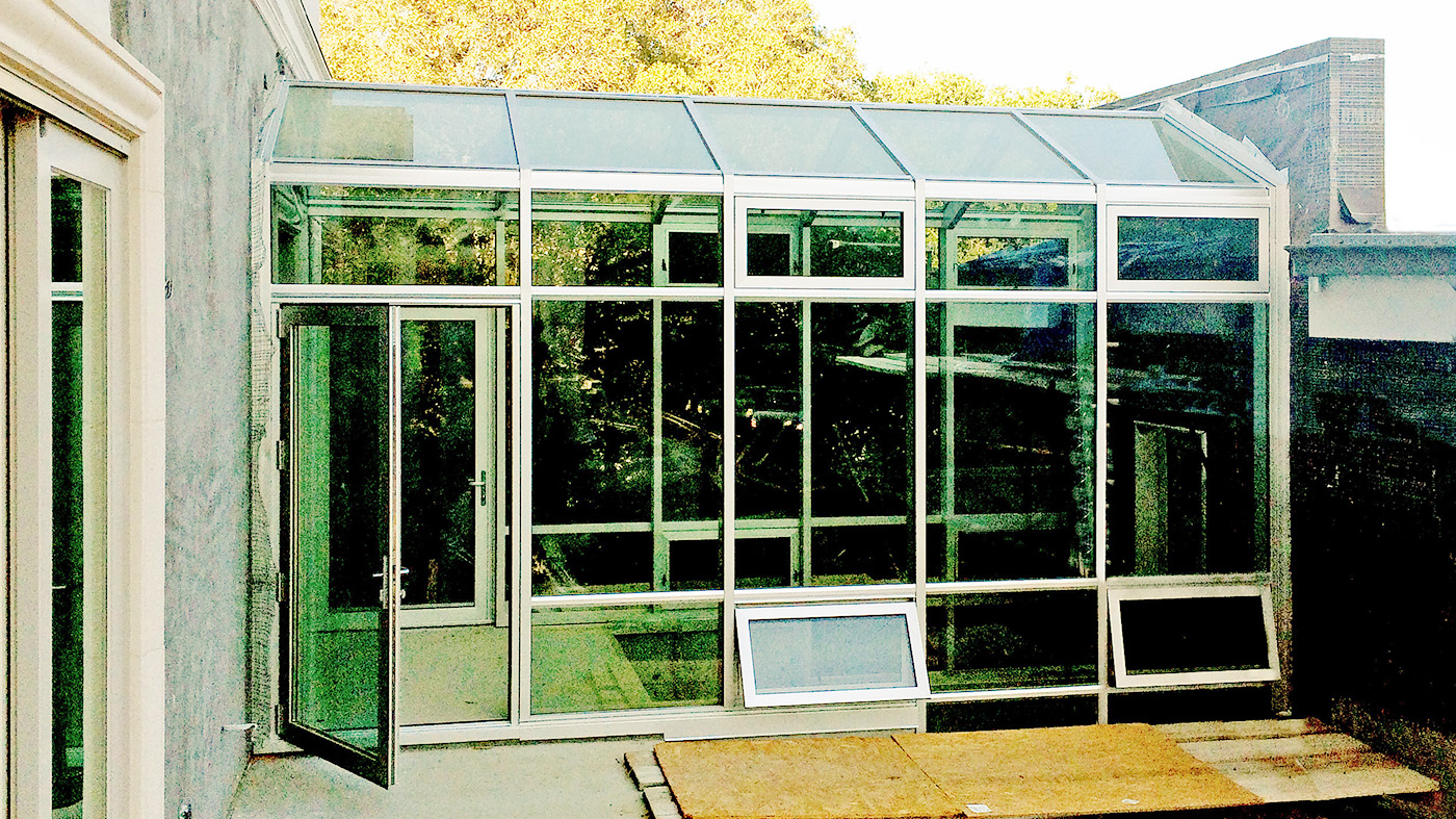 Straight eave double pitch walkway with two terrace doors and eight awning windows