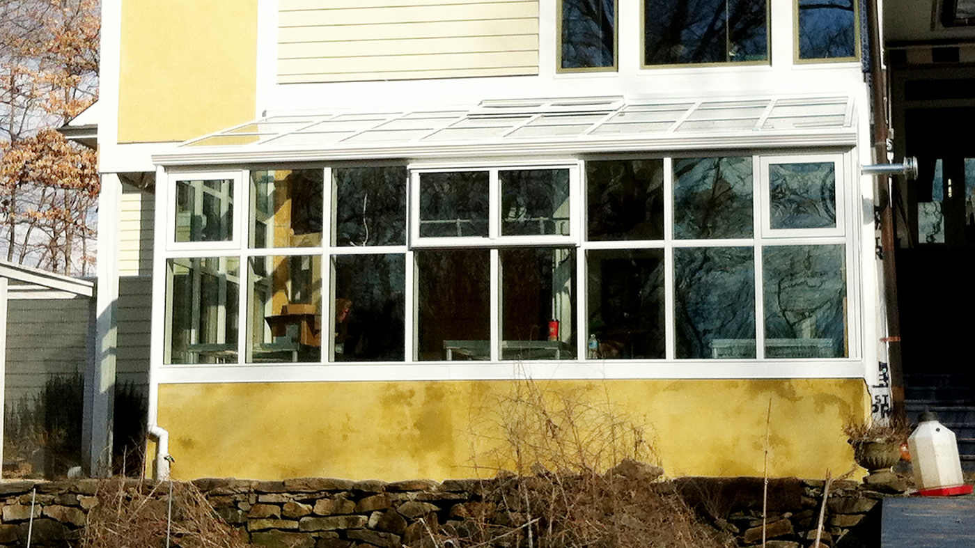 Straight eave lean-to greenhouse with two gable ends, ridge vents, eave vent, and awning windows.