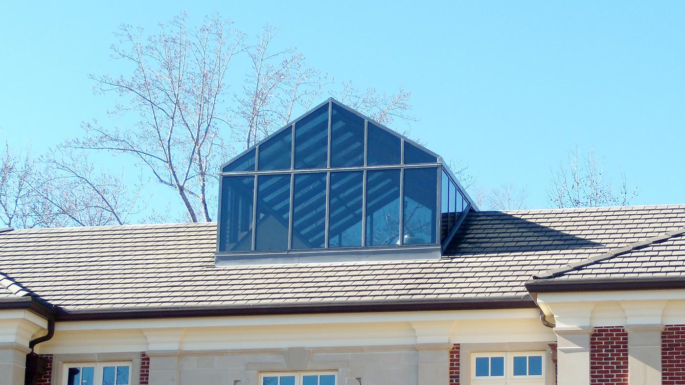 Straight eave, double pitch, Mahogany interior/aluminum exterior skylight with custom gable end.