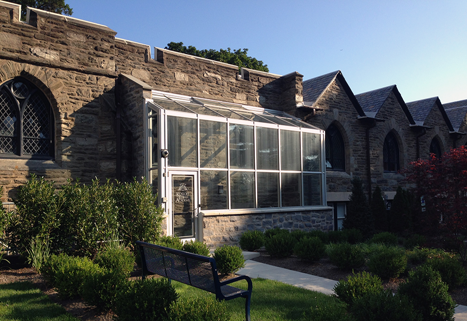 Straight eave lean-to sunroom with two gable ends, commercial terrace door, and manually operated ridge vent.