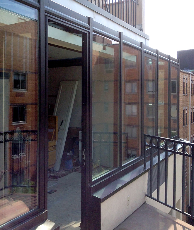 Straight eave lean-to sunroom with an integrated terrace door and casement windows