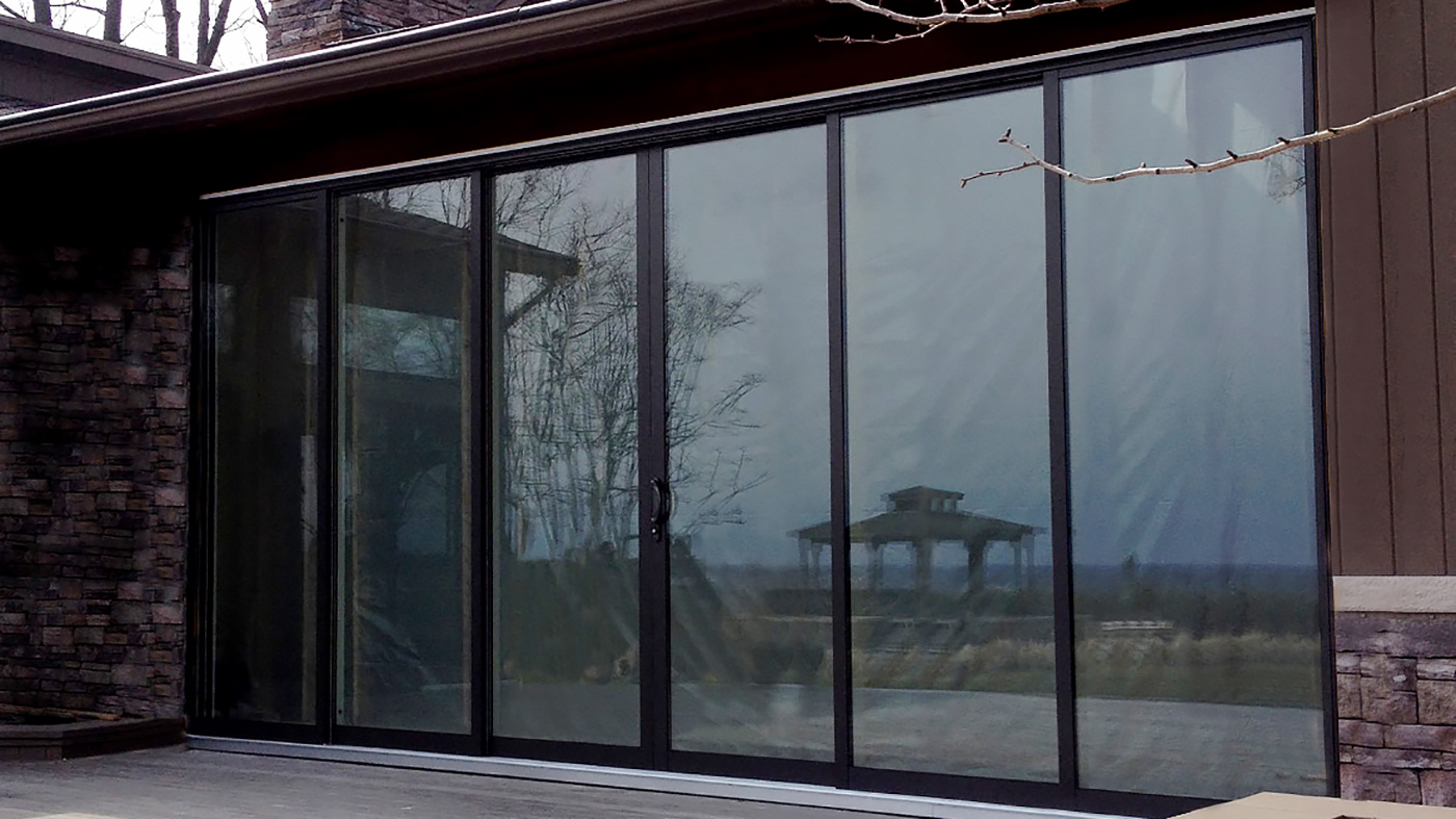 Multi track sliding glass door with OXXXXO configuration and two tone frame finish.