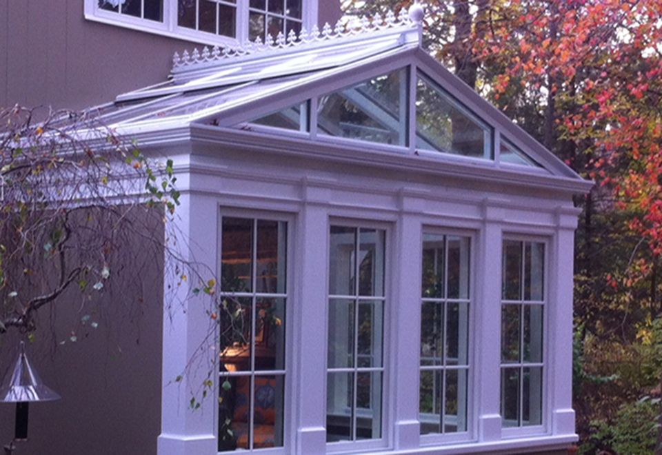 One straight eave, double pitch pitch skylight utilizing Solar's 4.5 inch bar system. The structure also includes decorative columns and ridge cresting.