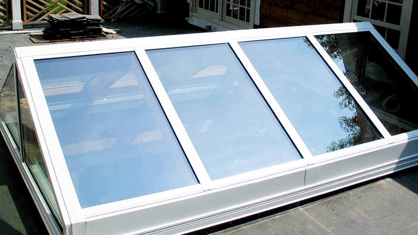 Straight eave, double pitch skylight with Mahogany interior.