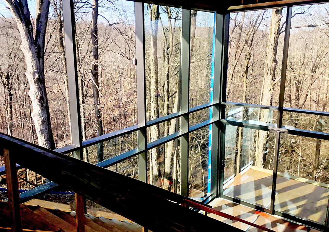 Complete glazing package including: aluminum curtain walls, multi-track sliding glass doors, bifold doors, casement, awning and tilt-turn windows, and B-Series retractable screens.