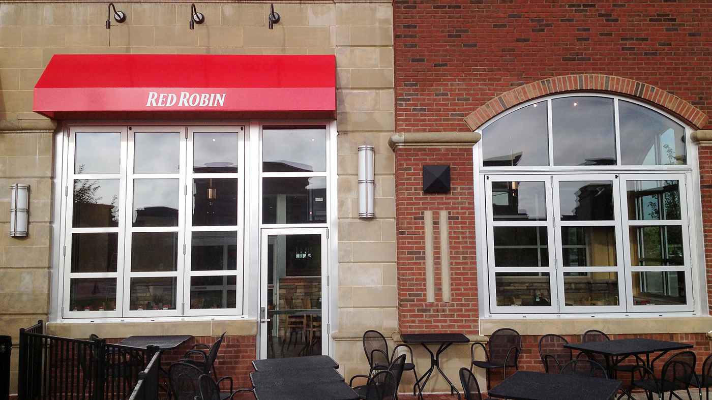 Folding glass wall, one folding window, vertical wall transom, and a terrace door used on a commercial restaurant application. The folding units feature all wall configuration, horizontal mullions, and standard sills.