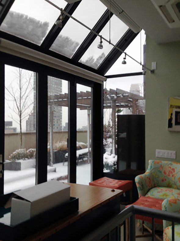 Straight eave, lean-to sunroom with no gable ends, a single door last panel folding glass wall, interior roof mounted shades, and interior roller vertical shades.