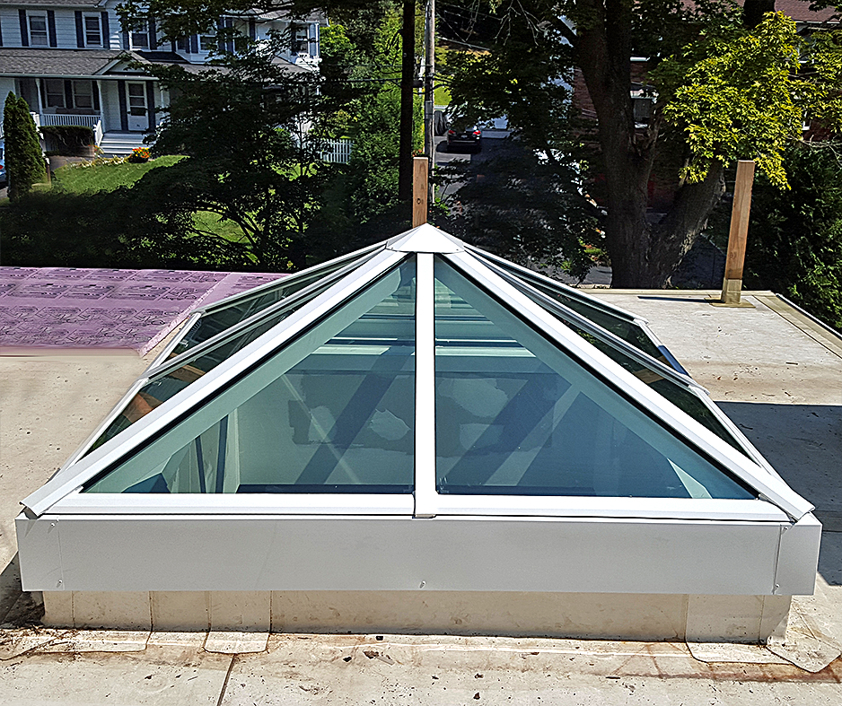 Curb mount pyramid skylight.