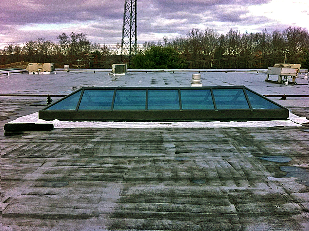 Double pitch skylight with two gable ends.