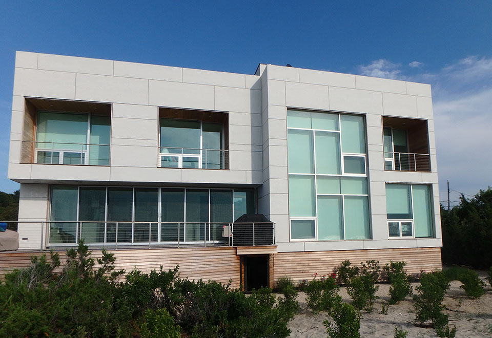 This complete glazing package adds the perfect touch for this modern beach home.