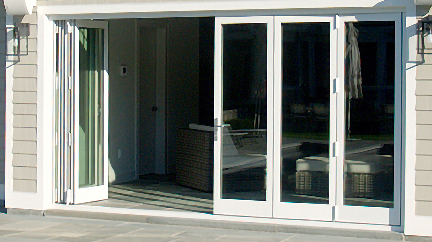 The folding glass wall system features a G2 narrow vertical frame, as well as a heavy bottom rail.