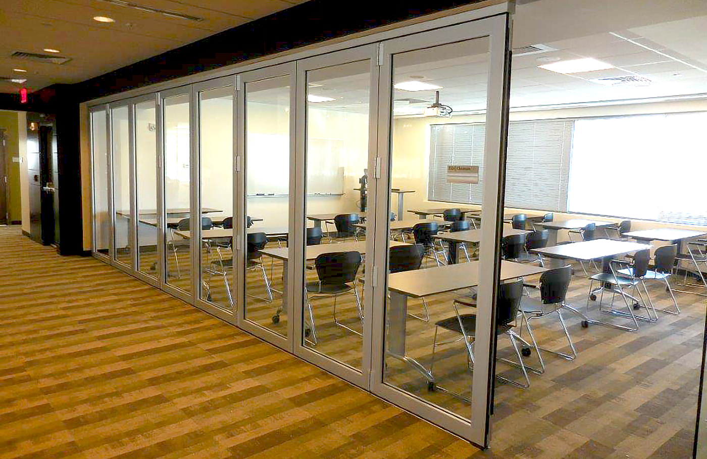 This project features multiple folding glass wall systems with all wall configurations.