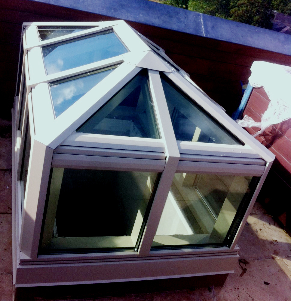 Hip end double pitch skylight with transom