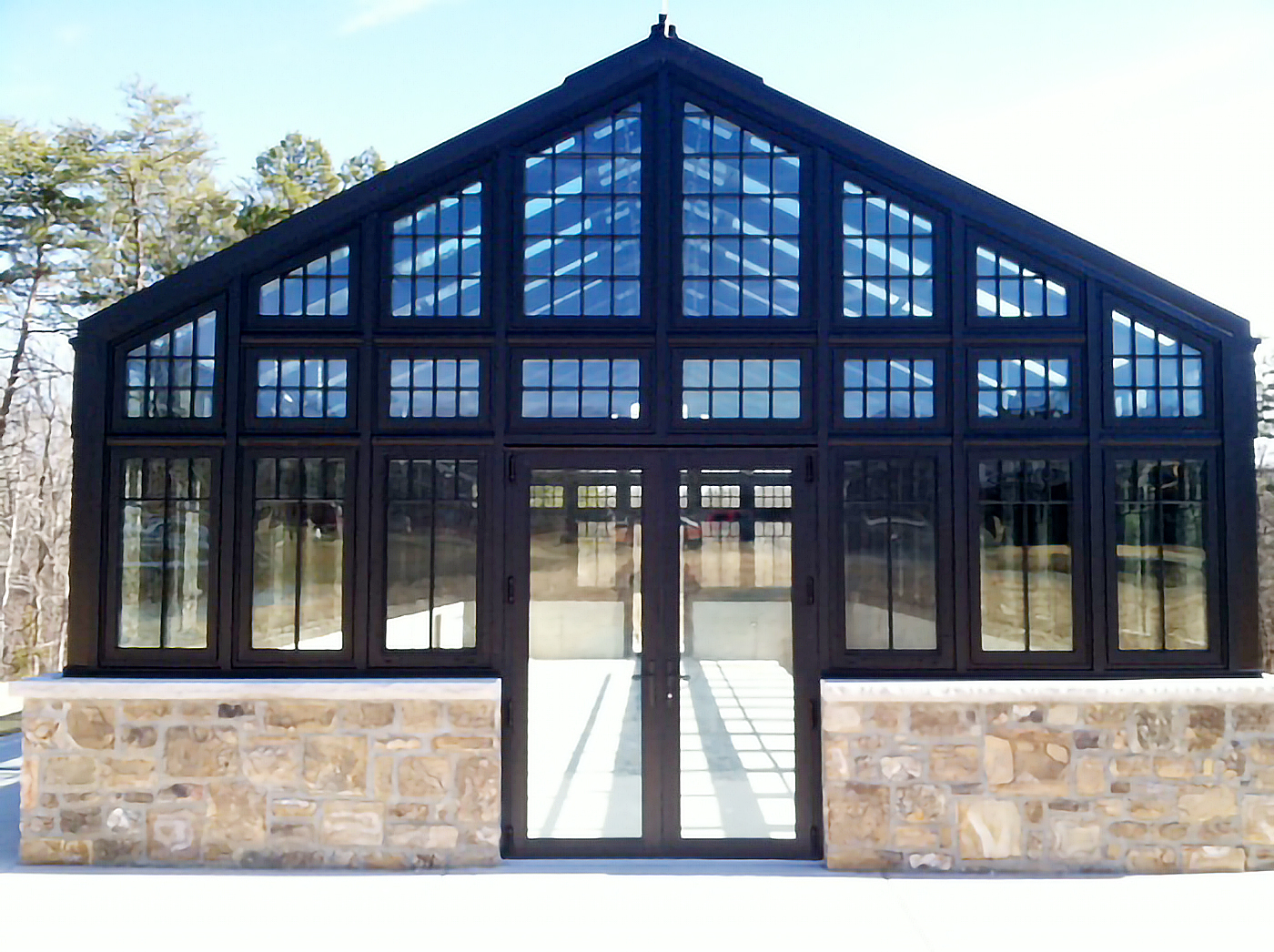 This one straight eave, double pitch greenhouse with two gable ends includes G1 International windows. The greenhouse includes a variety of accessories including eave vents, ridge vents, thermostats to control temperatures, and isolation relays.