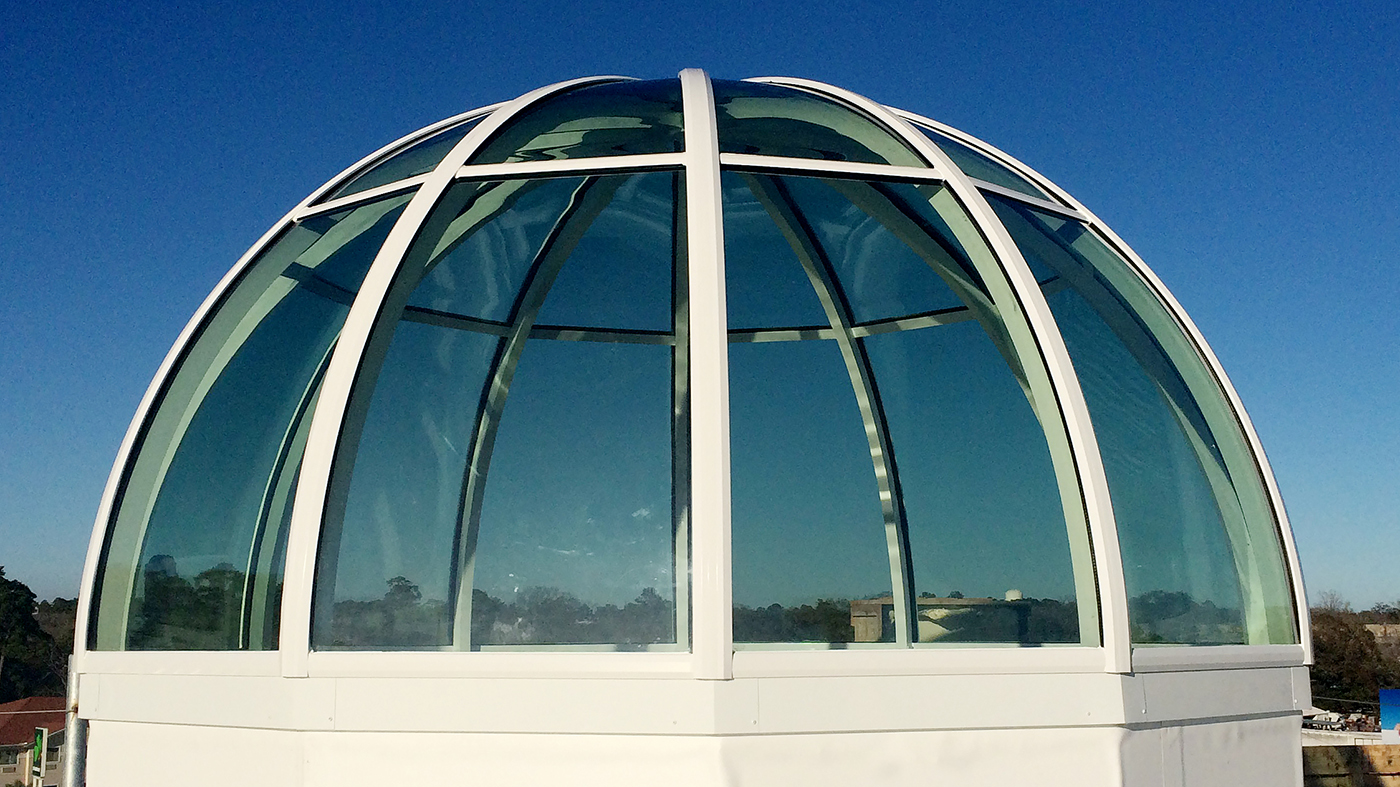 True radius dome skylight with 12 segmented sills installed at a bank. Architect: Patterson Architects