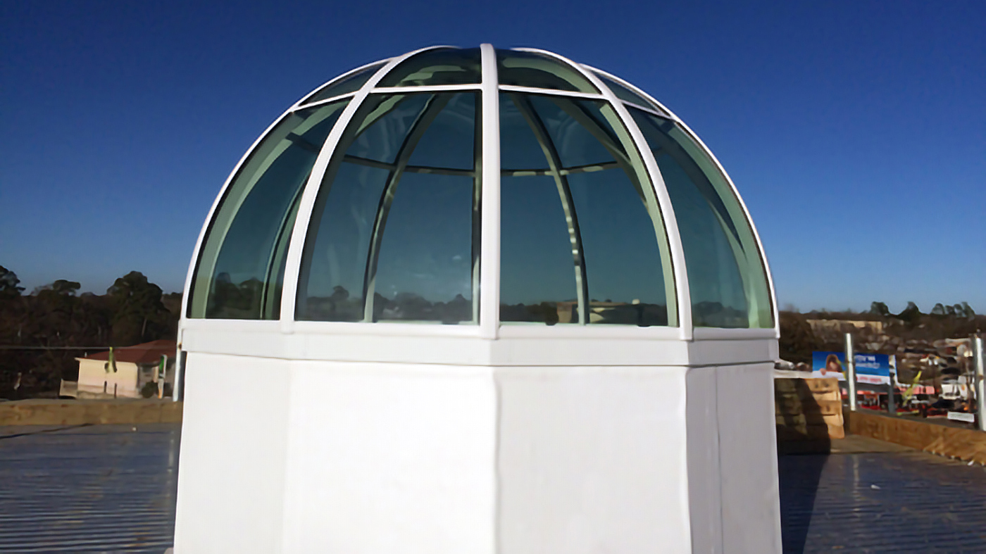 True radius dome skylight with 12 segmented sills installed at a bank.