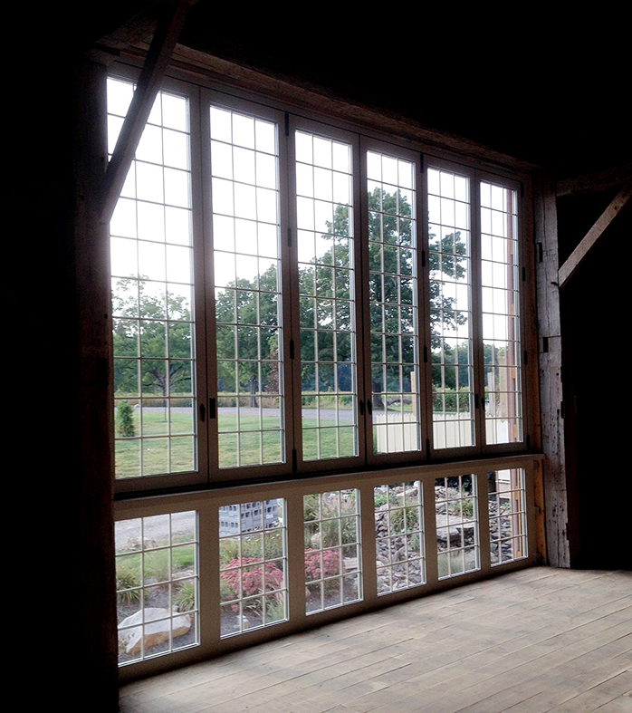 Folding glass wall with interior muntins.