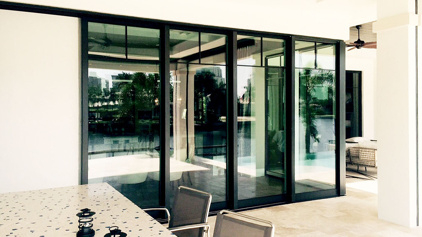Features multiple sliding glass door systems  with OXXO and XXO configurations.