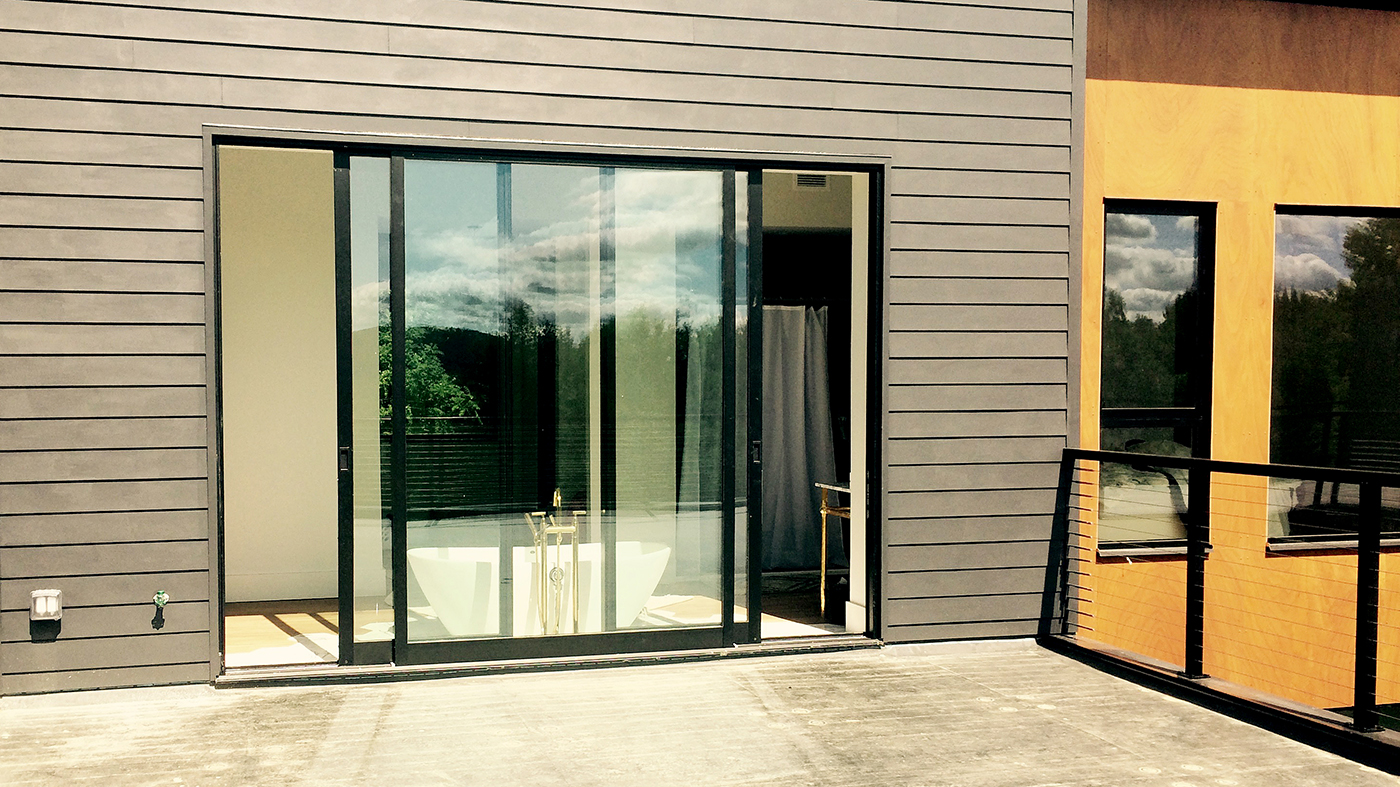 One G2 out-swing terrace door with sidelights.