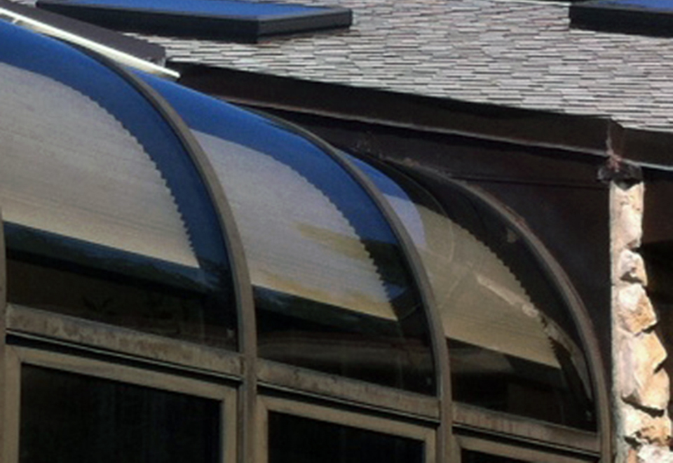 Curved glass replacement on this curved eave, lean-to sunroom.