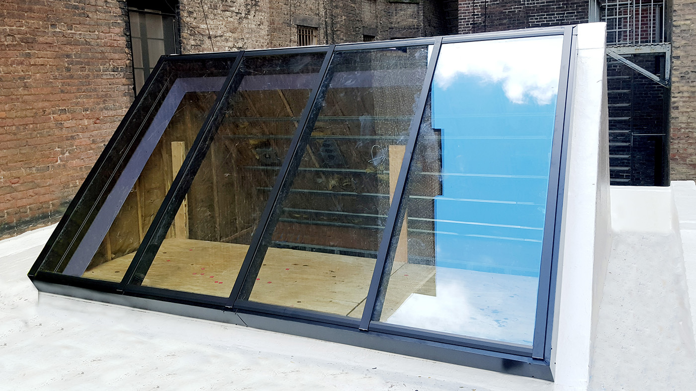 One single slope skylight and one straight eave double pitch skylight
