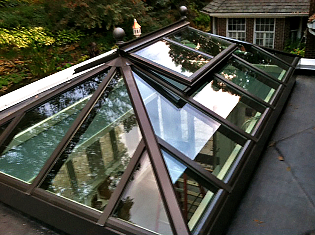 Curb mount double pitch skylight with two gable ends.