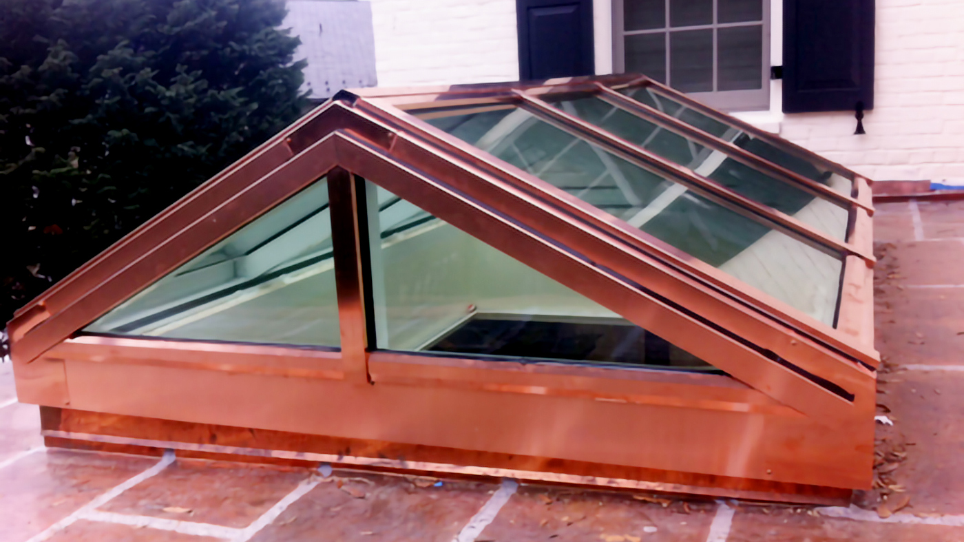 One straight eave, double pitch skylight with two gable ends featuring a Copper cladding exterior finish.