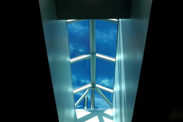 Curb mount straight eave double pitch skylight.