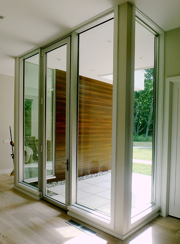 Featuring a curtain wall on this complete glazing package.